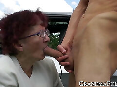 Redhead grandma sucks off young guy at secret outdoor place