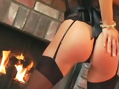 Crissy teases in stockings a garter and high heels