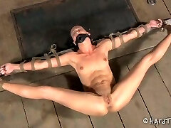 Slim brunette is restrained and tied up before pussy penalizing