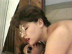 Brunette blows 2 cocks together