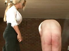 Mistress spanks and uses slave