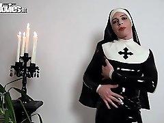 Bitchy latex nun fondling her kinky latex costume