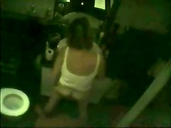 Hidden cam caught cougar fingering in front of mirror