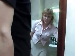 Mature mom takes a pee on the toilet and gets interrupted by her son-in-law for a fuck