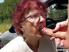 Kinky granny gives a blowjob and tugjob to one coddled young dude