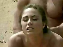 Dark-haired getting laid on beach