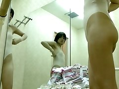 Sexy Asian gets her nudity packaged in tricot on voyeur cam