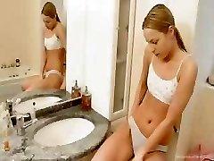 Blonde sweetheart fingering in a bathroom