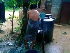 Sri Lankan Girl Bath In Outside