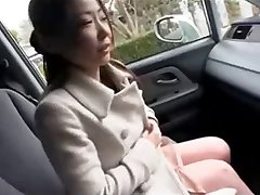 Asian MILF shows big nipples in car