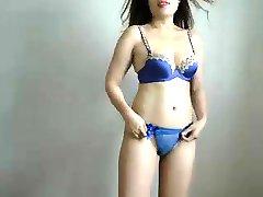 Pretty Oriental babe in blue underwear reveals the curves o