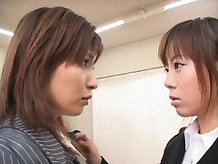Two japanese business women swap and swallow cum