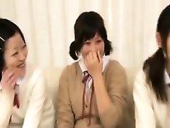 Enticing Oriental schoolgirls wrap their sweet lips around