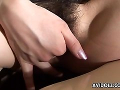 Asian lass with a hairy cunt masturbates on a
