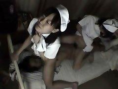 Nurses bind up patient