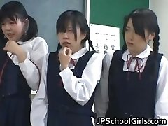 Asian college girls in the classroom are partTwo