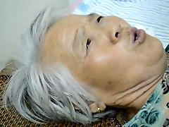 Chinese Granny With Agonizing Orgasm