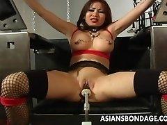 Huge-boobed brunette getting her wet cooch machine fucked