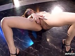 Japanese stripper getting wild on the pole as she masturbates