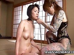Tattooed up Asian domina strap on pounding the victim