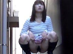 Furry asian urinates street