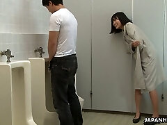 Insatiable Asian chick Uta Kohaku pisses on dick of one stranger dude in a public toilet