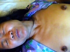 Ugly asian labia lies on bed