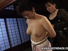 Mature bitch gets strapped up and suspended in a bdsm session