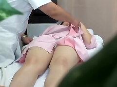 Japanese babe gets fingerblasted during erotic massage session