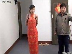 Chinese doll in restrain bondage