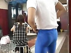 Muscular dude flashes very cute busty Asian chick in a bar