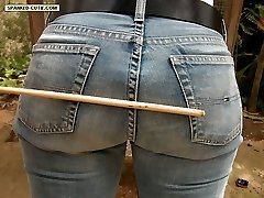 Outdoor caning for pretty girl on her buxom ripe buttocks - deep red stripes