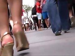 Candid asian business woman in tucks walking