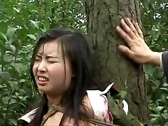Chinese army girl roped to tree 2