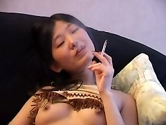 Asian Smoking Naked on Couch