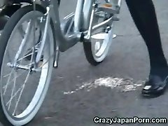 Schoolgirl Squirts on a Bike in Public!