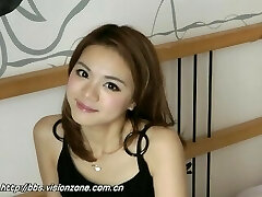 Pretty Chinese Doll's Nylon Feet On The Bed
