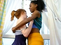 Indian and red-haired girl lesbians