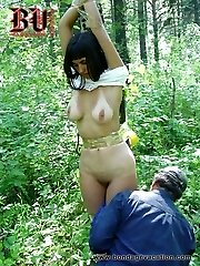 Cute student girl gets tied up in a forest