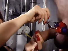 XXX vids of Mistress Suki and her slave in a suspended bondage while she spanks his ass raw