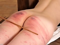 Fully naked, bound and caned severely