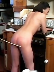 Naughty wife Steff strips her panties and offers her bare bottom for a good spanking