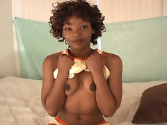 A petite ebony hottie getting fingered and sucking cock