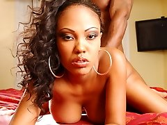 Black lady Lacey Duvalle gives a big wang a sexy oral job and gets her pussy fucked in many ways
