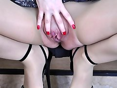 Leggy cutie gets to hot foot tease in barely there hose and open toe shoes