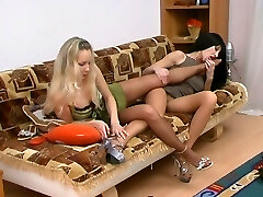 Spicy girlfriends fulfilling their nylon fantasies licking their mouth-watering feet