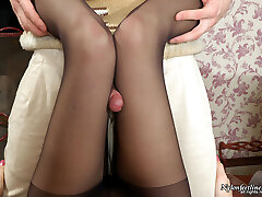 Eye Mask cutie getting her delicious feet clad in black pantyhose stroked