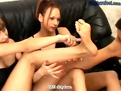 Cruel bitches in black enjoy forcing a slave to lick their dirty feet clean
