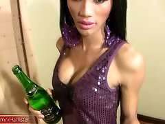 Ladyboy inserts champagne bottle in tight ass and eats cock