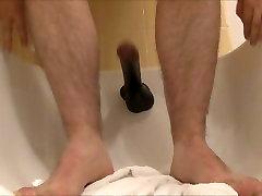 Wanking while fucking my 12 inch Black Dildo